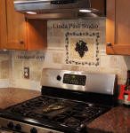 grape vine mosaic above stove
